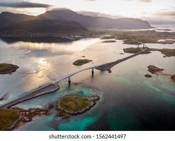 The Fredvang Bridges, Fredvangbruene, are two cantilever bridges at dusk in Lofoten, Norway.