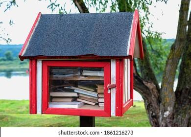 Free book sharing mini house near the river.