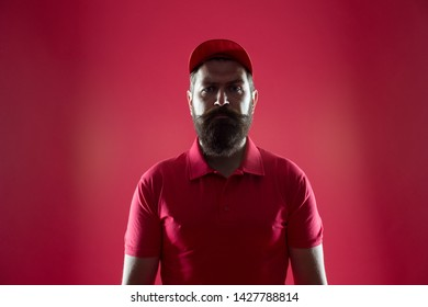 Free cashier. Restaurant cafe staff wanted. First job. Man bearded hipster wear cap and cashier uniform red background. Regular cashier concept. Salesman and cashier career. Hiring shop store worker.