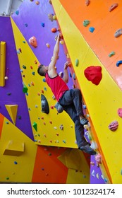 Free Climber Man Climbing On Color Practice Wall Indoors