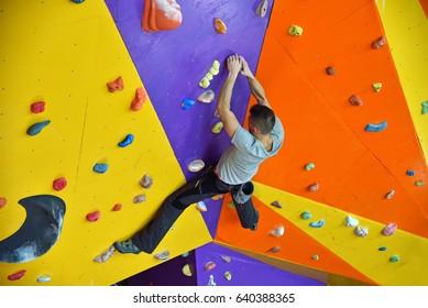 Free Climber Man Climbing On Practice Wall Indoors