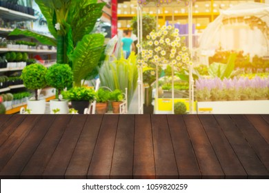 Free copy space on wood table with blurry Beautiful flower garden.