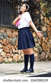 Free Cute Colombian Person Wearing Uniform With Notebook