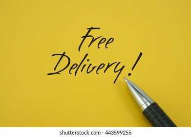 Free Delivery! note with pen on yellow background