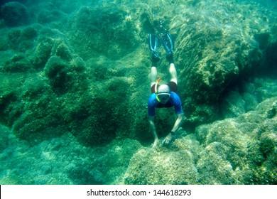 Free diver on the bottom. Mediterranean sea.