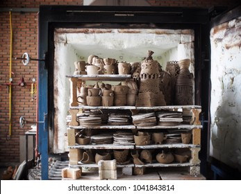 free form soft brown color hand formed clay for ceramic art & crafts production study under production process in a design school factory after forming process workshop ready to burn in small kiln
