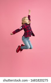 Free and happy, flying, jumping high. Caucasian girl's portrait on pink studio background. Beautiful model with blonde hair. Concept of human emotions, facial expression, sales, ad, youth, childhood.