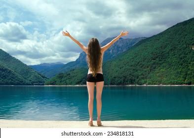 Free happy woman enjoying Beauty world. Enjoyment concept. The Piva Canyon. Montenegro, Balkans, Europe.