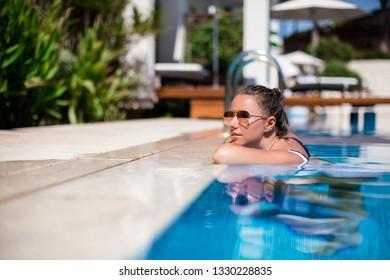 Free happy woman enjoying vacation. Beauty girl in luxury polside. Enjoyment.