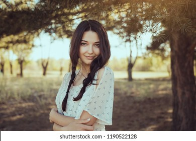 Free happy woman in forest enjoying nature. Natural beauty girl outdoor in freedom enjoyment concept. Tender mixed race Caucasian Asian girl posing on travel vacation holidays in dress. Close-up