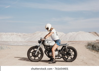free independent woman driving on motorbike across the sand, jorney atmosphere
