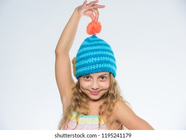 Free knitting patterns. Fall winter season accessory. Childrens knitted hats. Girl long hair happy face white background. Kid wear warm soft knitted blue hat. Difference between knitting and crochet.