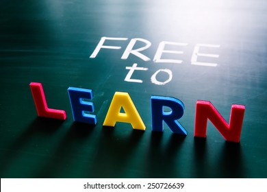 Free to learn concept, colorful words on blackboard