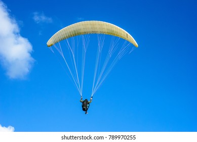 Free Paraglider on sunny day near Las Gaviotas. Tenerife, Canary Islands.