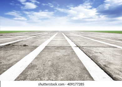 Free place for your car, plane, bike or people and gray road of runway and white marks