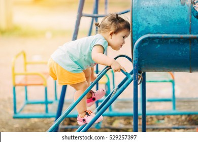 Free play in the playground for baby and toddler is important activity for child development.The kid can learn and enjoy the fresh air, explore sights and sounds and tests out her developing skills.