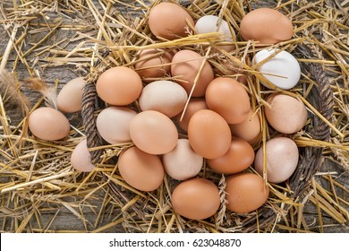 Free range eggs in a basket on a rustic background