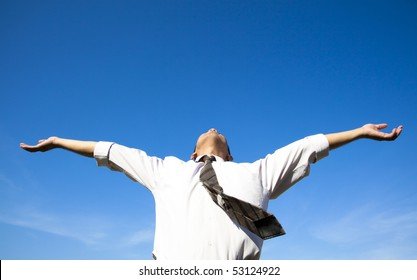 free and relax of businessman under blue sky