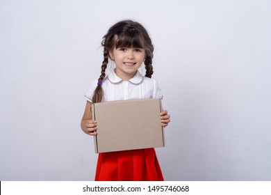 Free shipment, sale. Happy little kid son with cardboard box. Cute child toddler clients receiving carton package. Post mail parcel delivery service concept.