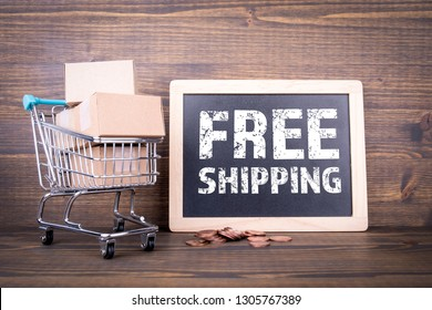 Free shipping concept. Paper boxes on wooden background