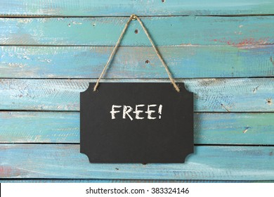 Free sign on blue wood background