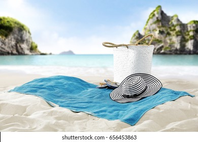 Free space on towel on sand and landscape of tropical beach