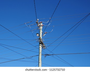 Free standing residential power line mast with wires in all directions, Melbourne 2018