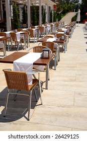 Free tables of restaurant under the hot sun