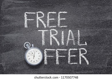 free trial offer phrase written on chalkboard with vintage stopwatch used instead of O