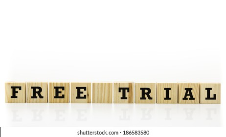 Free trial written on row of wooden blocks. Isolated over white background.
