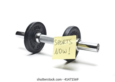free weights with a note in front of white