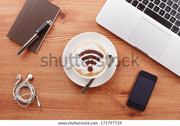Free wifi area sign on a latte coffee in a business table