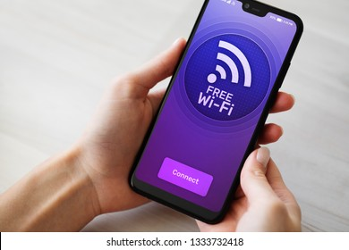 Free wifi connection on mobile phone screen. Internet and telecommunication technology concept.