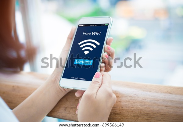 Free wifi.Close-up of female hands holding mobile phone