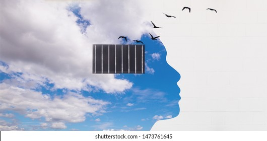 Free your mind concept and think out of the box concept, Panoramic blue sky with human head shape and security window bar in the head on the white wall with birds flying out from the window