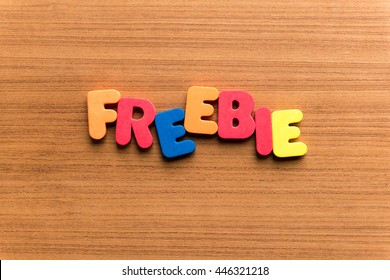 freebie colorful word on the wooden background