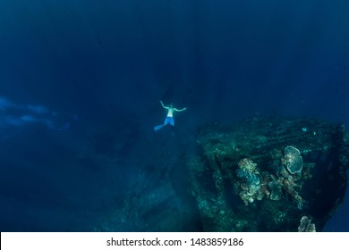 Freediver in the depth make ring bubble in underwater