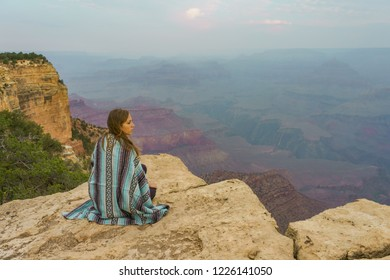 Freedom and adventure - woman happy in Grand Canyon. Free cheering attractive girl enjoying serene sunset. Female model in Grand Canyon, USA. Young beautiful woman traveling. amazing landscape views.
