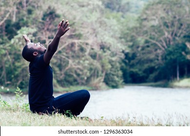 Freedom African Man Enjoying and relax with in green natural background.