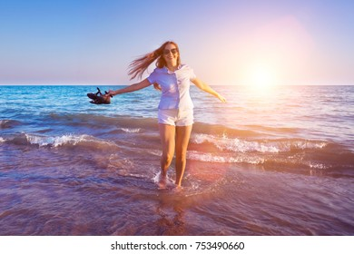 Freedom alone young woman walking on a sea or ocean shore
