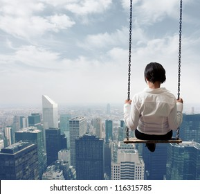 Freedom business woman on a swing