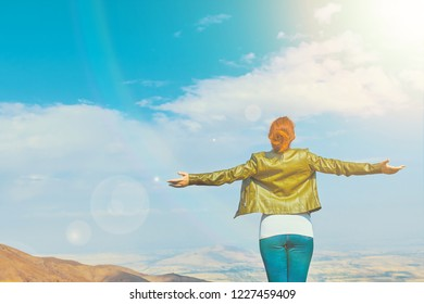 Freedom concept. Beauty woman outdoors enjoying nature. Free Woman Enjoying Nature. Happiness Female Outdoors.
