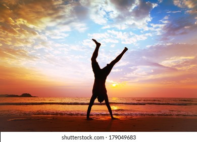 freedom and creativity, man jumping on the beach
