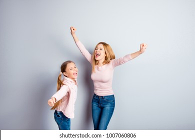 Freedom dreamy wish emotions people chill rest relax positivity win winner concept. Excited cheerful glad friendly impressed  cute kid and mum raising hands up casual jeans isolated on gray background