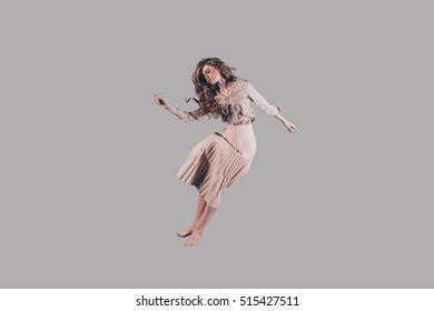 Freedom in every move. Studio shot of attractive young woman hovering in air