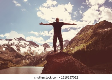 Freedom. Free man with open arms on sunset. success. Travel. Good life. Backpacker, Hiking the conquest of mountain climbing.