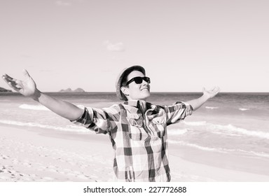 Freedom, happiness and enjoyment concept - Happy male enjoying beautiful day at the beach