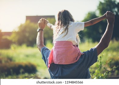 Freedom and happiness. Grandfather and granddaughter spending time together in nature. Carrying on shoulders. Copy space.