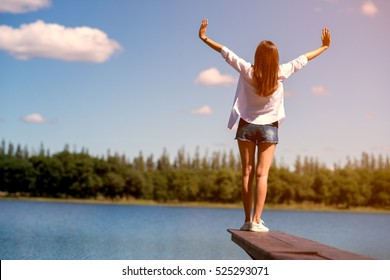 freedom happy Woman Enjoying Nature. Beauty Girl Outdoor. lifestyle concept. Beauty Girl over Sky and Sun. Enjoyment.
