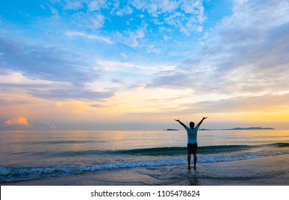 Freedom human and refresh concept with beautiful sunset sky background at dusk beach